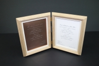Wedding invitation in a double hinged frame